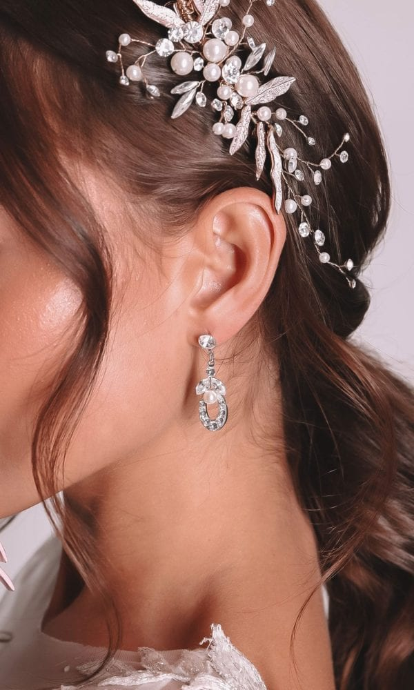 Vinka Design Bridal Accessories - Bridal Earrings - Victoria - available from Vinka Design Auckland bridal store. horse shoe earrings worn with headpiece