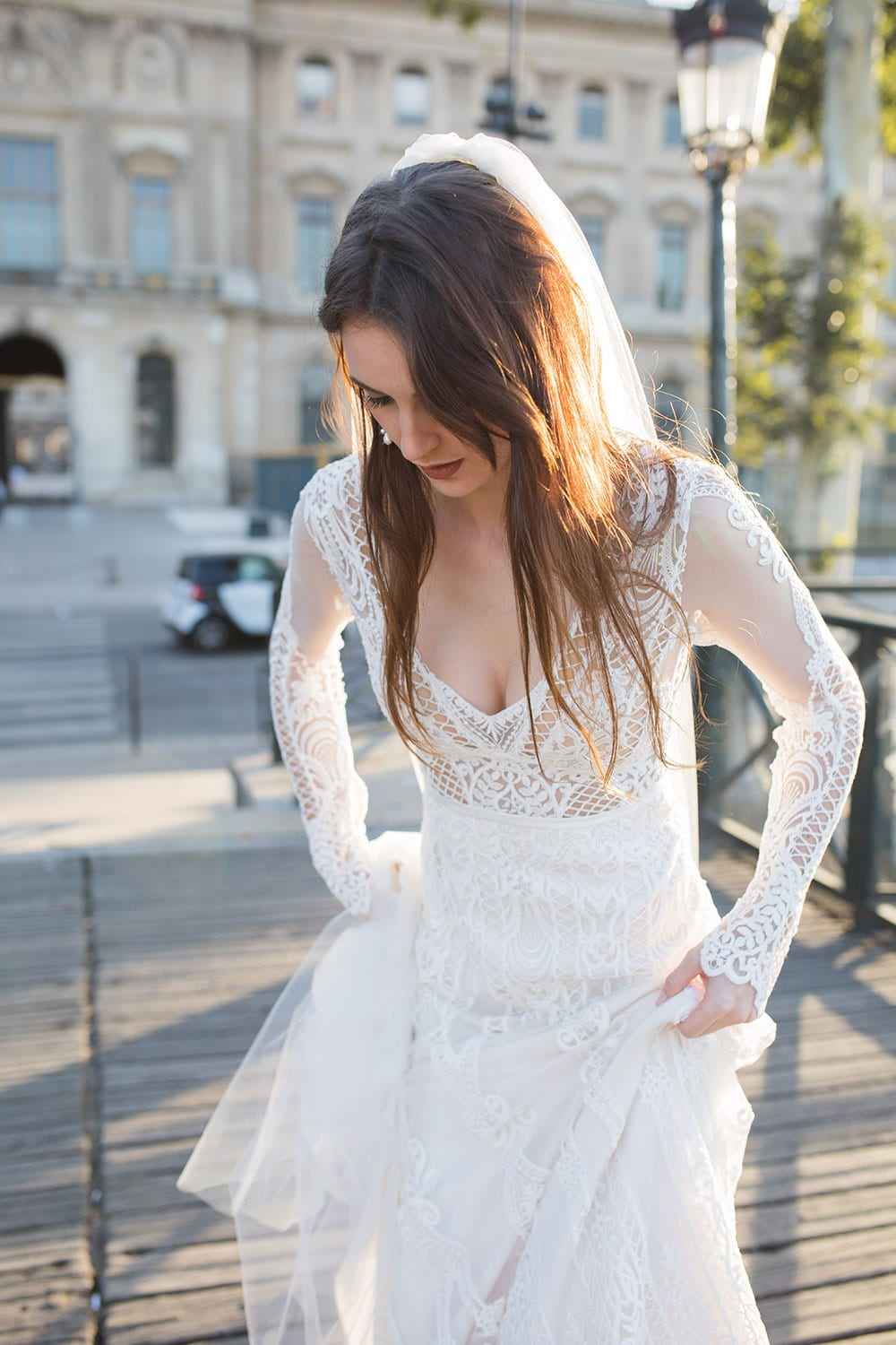 Model wearing Vinka Design Briar Wedding Dress, an Embroidered Lace Wedding Gown in Paris close up showing front detail