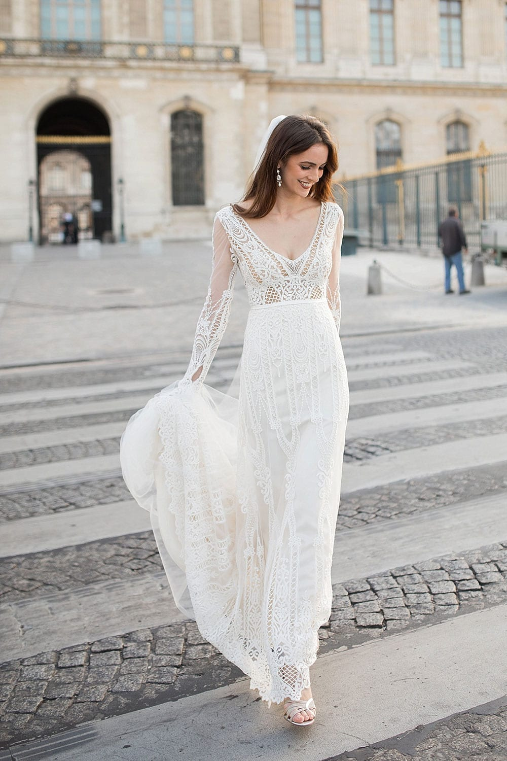 Model wearing Vinka Design Briar Wedding Dress, an Embroidered Lace Wedding Gown in Paris