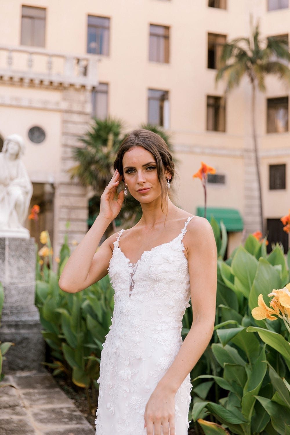 Model wearing Vinka Design Alicia Wedding Dress, a Embroidered Wedding Gown with the skirt removed close up portrait in front the Hotel Nacional in Havana Cuba