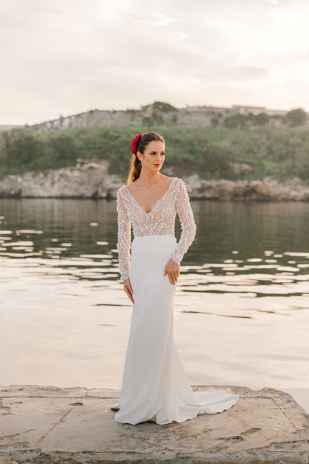 Model wearing Vinka Design Angela Wedding Dress, Fitted Wedding Gown with Lace Bodice worn next to the water in Havana Cuba