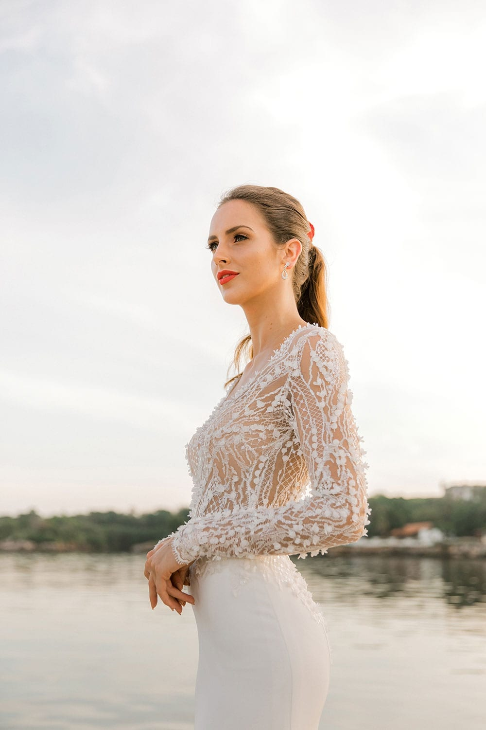 Model wearing Vinka Design Angela Wedding Dress, Fitted Wedding Gown with Lace Bodice cloe up showing detail of lace bodice in Havana