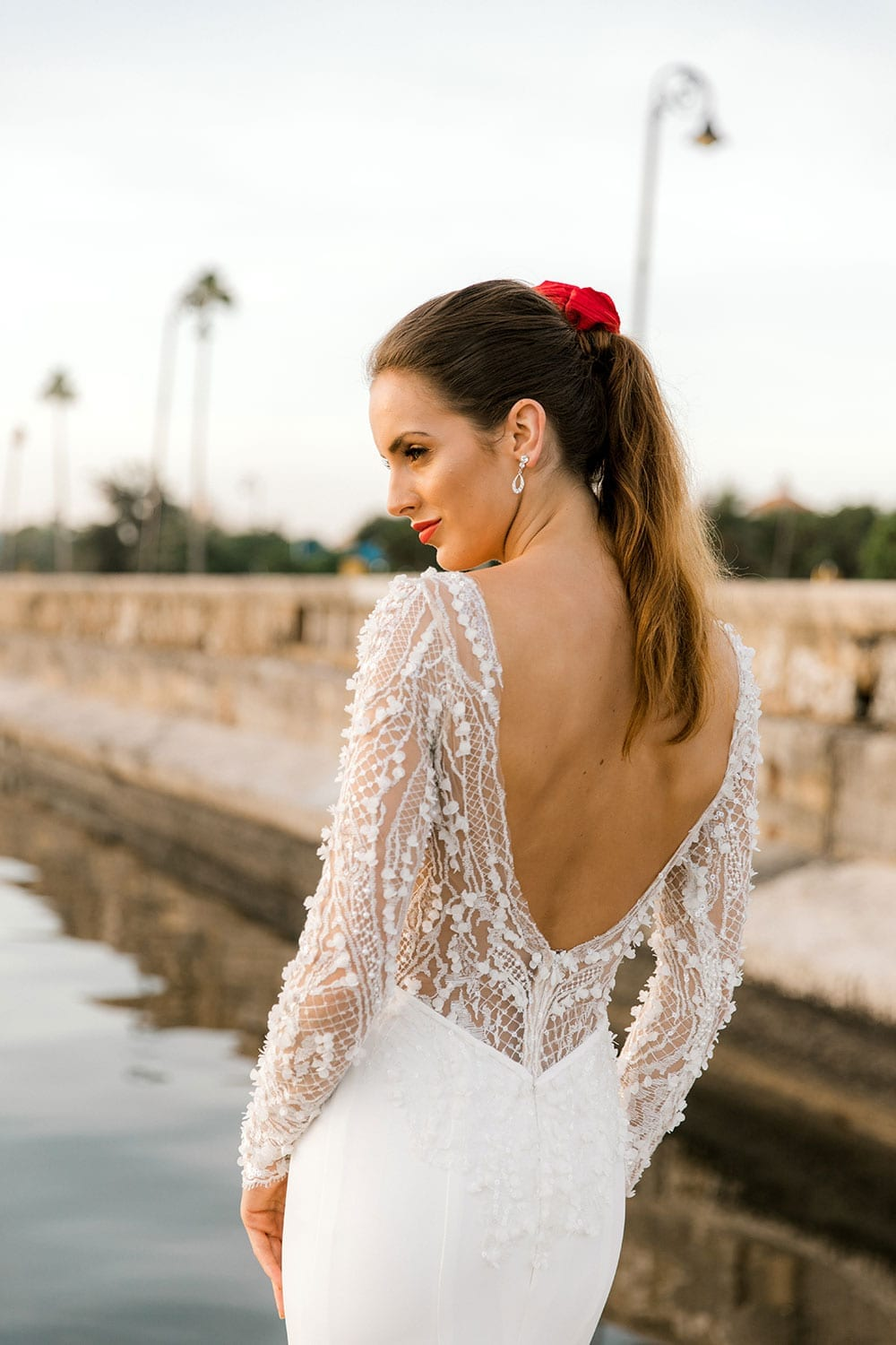 Model wearing Vinka Design Angela Wedding Dress, Fitted Wedding Gown with Lace Bodice close up detail of low back lace bodice, in Havana