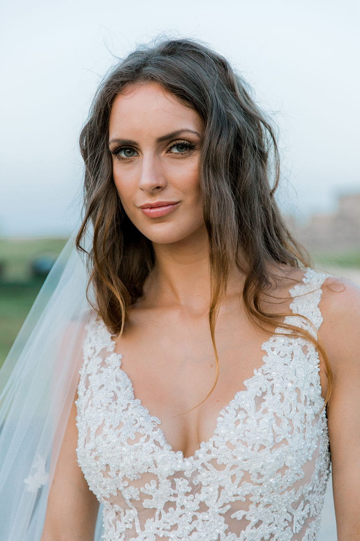Model wearing Vinka Design Clara Wedding Dress, a Silk Chiffon Beaded Lace Wedding Gown close up of dress detail