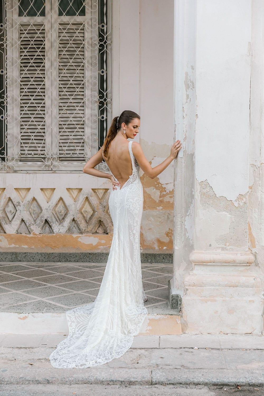 Model wearing Vinka Design Indi Wedding Dress, a Lace Fitted Wedding Gown in beautiful Havana