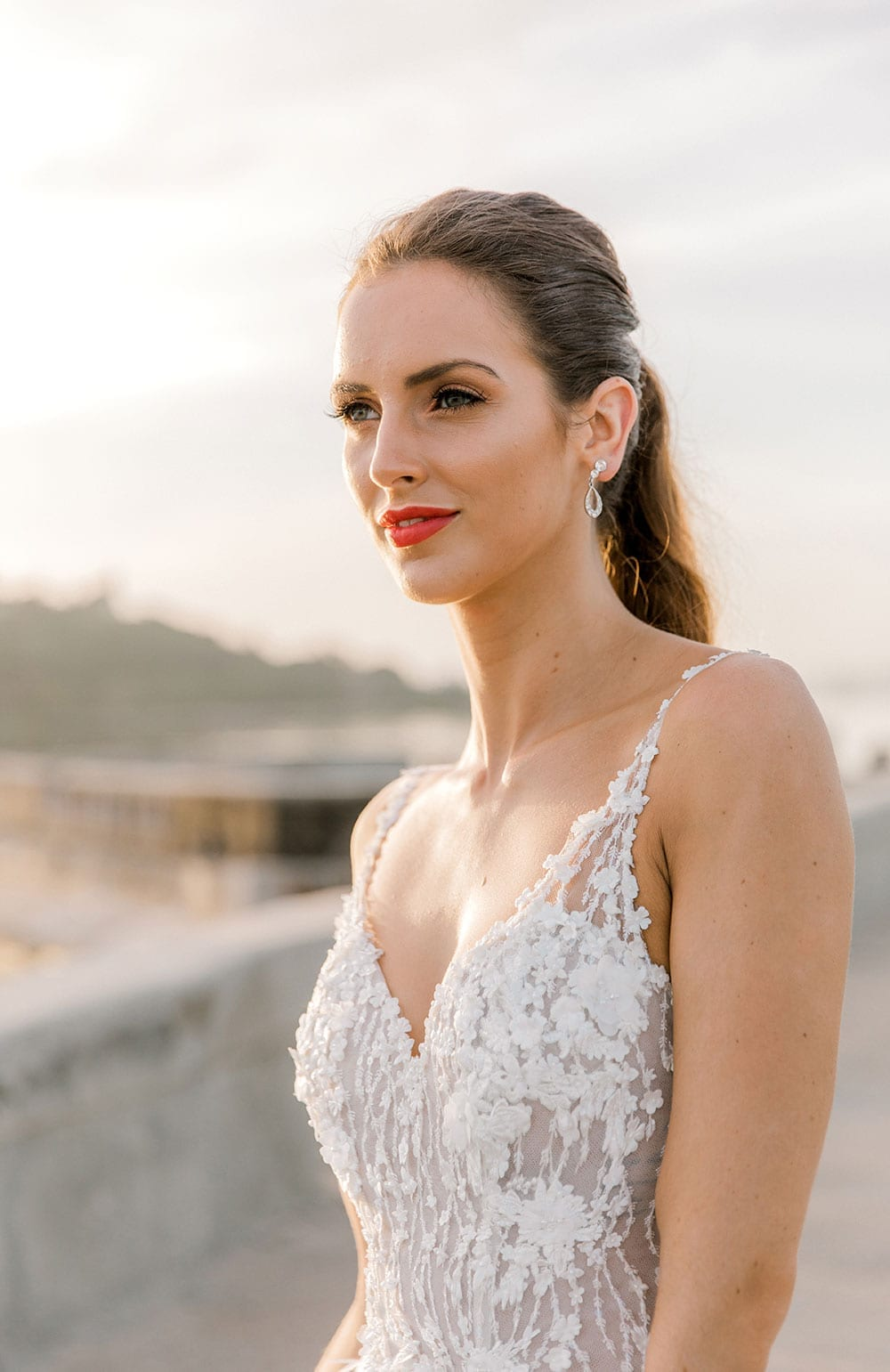 Model wearing Vinka Design Iris Wedding Dress, a Silk Chiffon Wedding Gown posed on a paved walkway in Havana close up