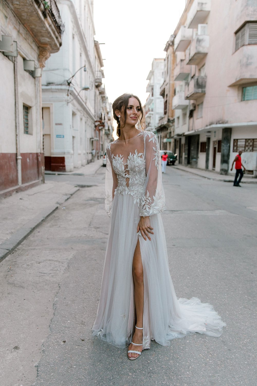 Model wearing Vinka Design Ivy Wedding Dress, a Silk and Tulle Wedding Gown with lace and Swarovski crystals in the streets of Havana