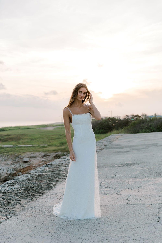 Model wearing Vinka Design Lolita Wedding Dress, a Fitted Beaded Wedding Gown on a path of Havana