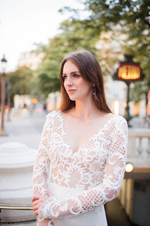 Model wearing Vinka Design Katrina Wedding Dress, a Sheer Beaded Lace Wedding Gown close up of front dress detail