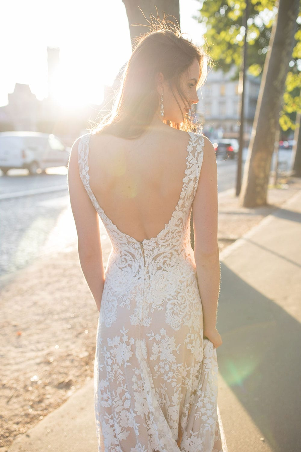 Model wearing Vinka Design Kerrie Wedding Dress, a V-Neck Lace Gown on Blush Silk Base with Low Back close up of the bare back with the low dress