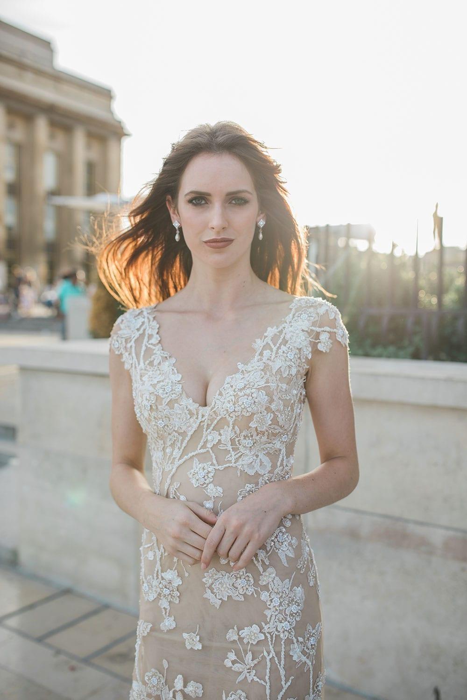 Model wearing Vinka Design Vianna Wedding Dress, a Low Back Beaded Wedding Gown in Parisian plaza