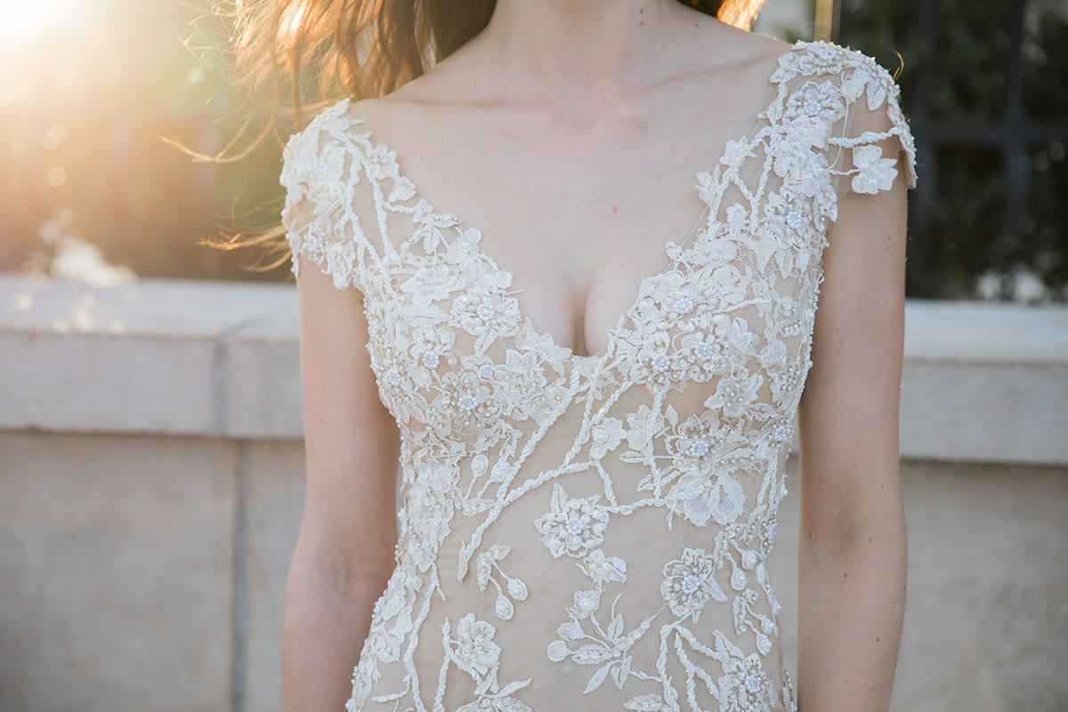 Model wearing Vinka Design Vianna Wedding Dress, a Low Back Beaded Wedding Gown with train close up of dress in Paris