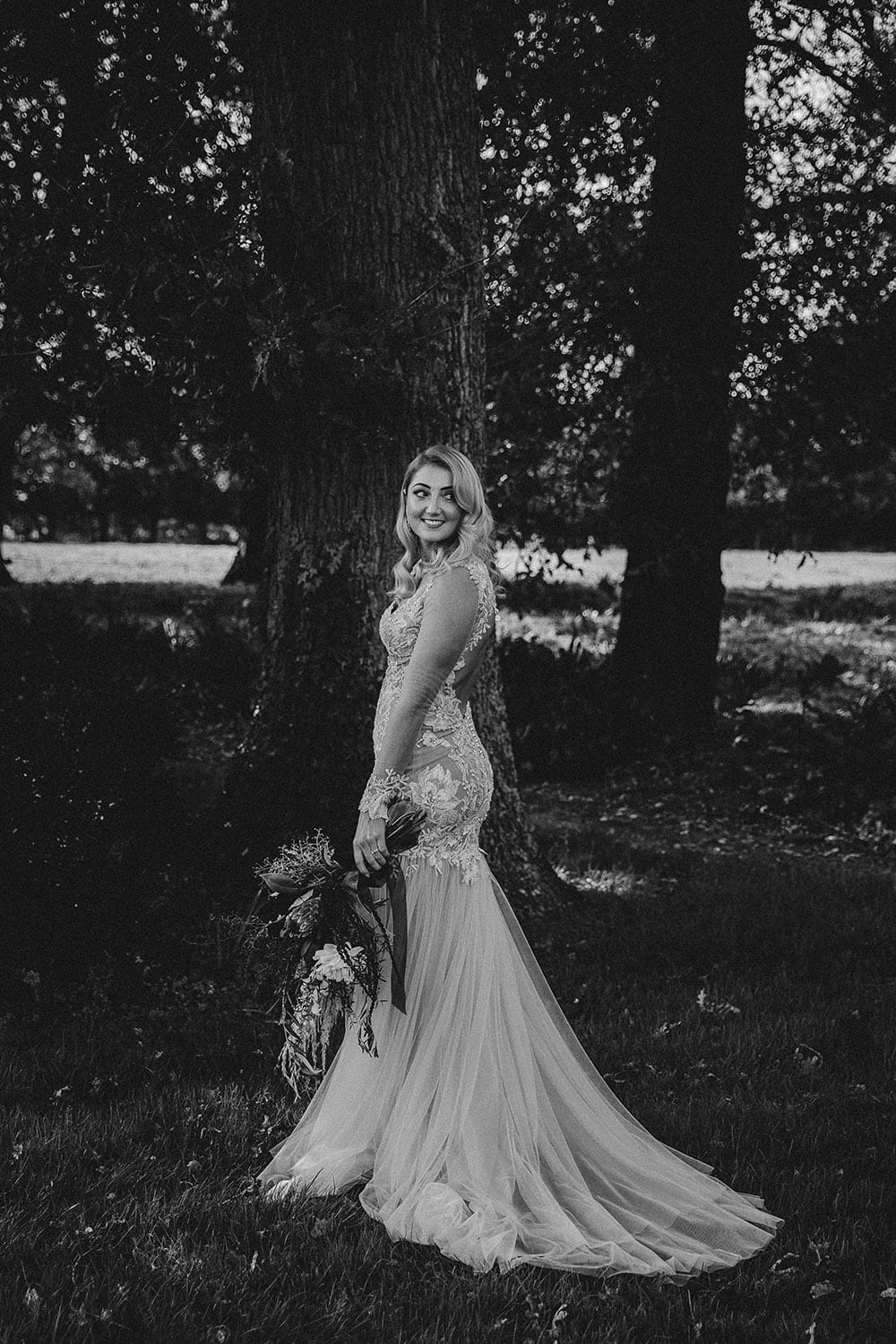 Real Weddings | Vinka Design | Real Brides Wearing Vinka Gowns | Rikki-Lee and Adam - Rikki-Lee portrait with lace detail of bespoke dress displayed with chiffon layers inblack and white