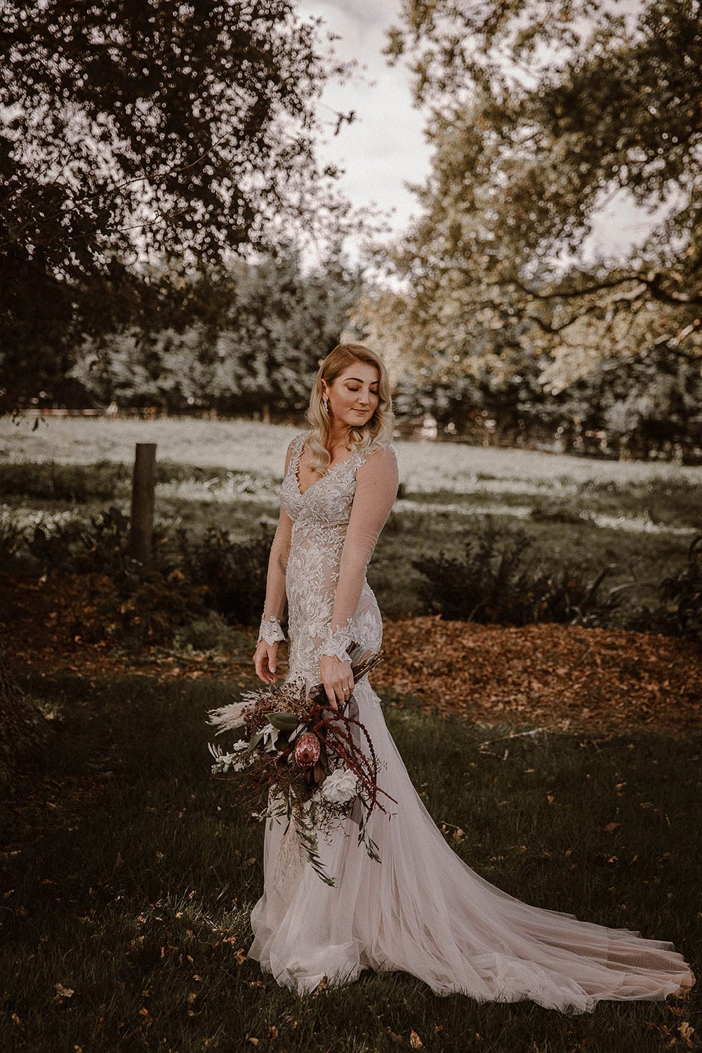 Real Weddings | Vinka Design | Real Brides Wearing Vinka Gowns | Rikki-Lee and Adam -Rikki-Lee side portrait with lace detail of bespoke dress displayed with chiffon layers