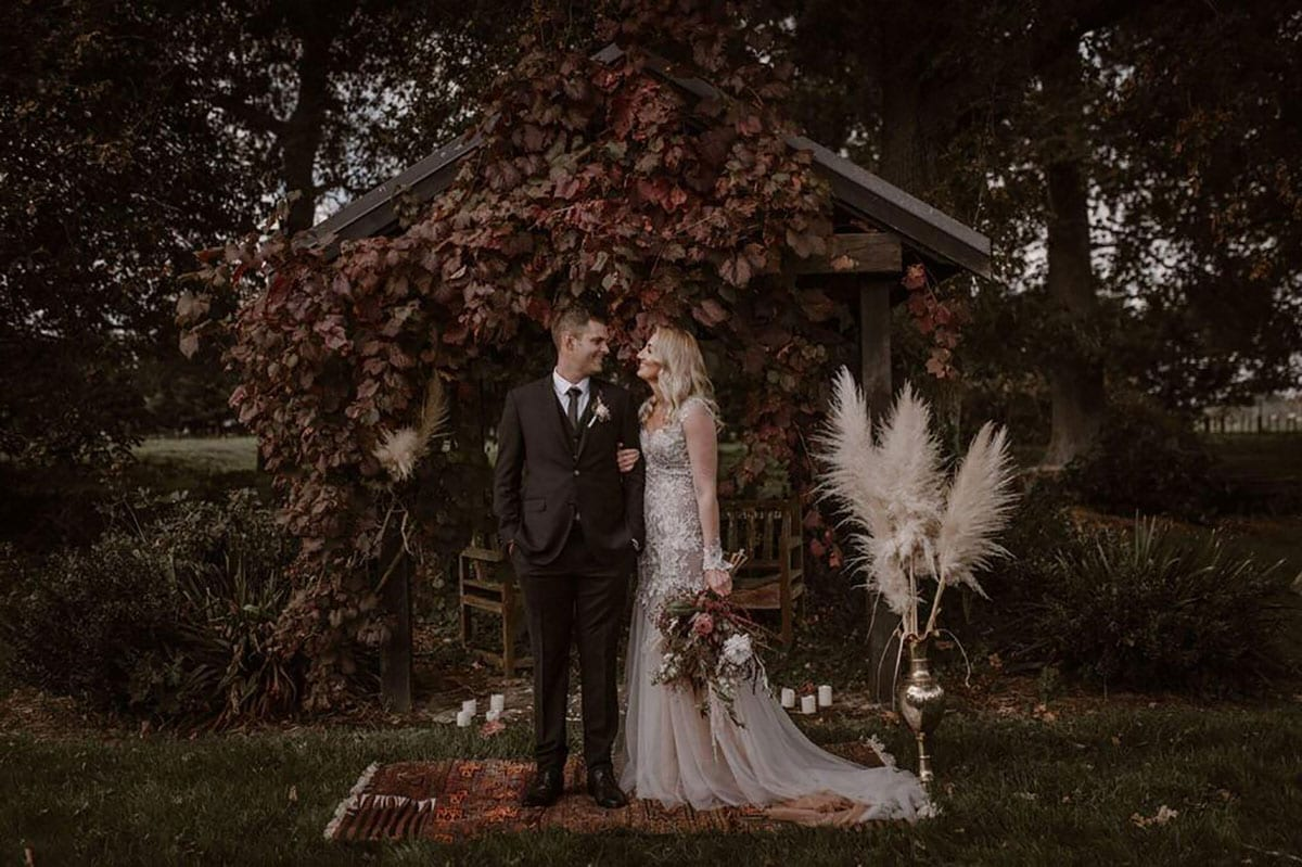 Real Weddings | Vinka Design | Real Brides Wearing Vinka Gowns | Rikki-Lee and Adam portrait with lace detail of bespoke dress displayed with chiffon layers