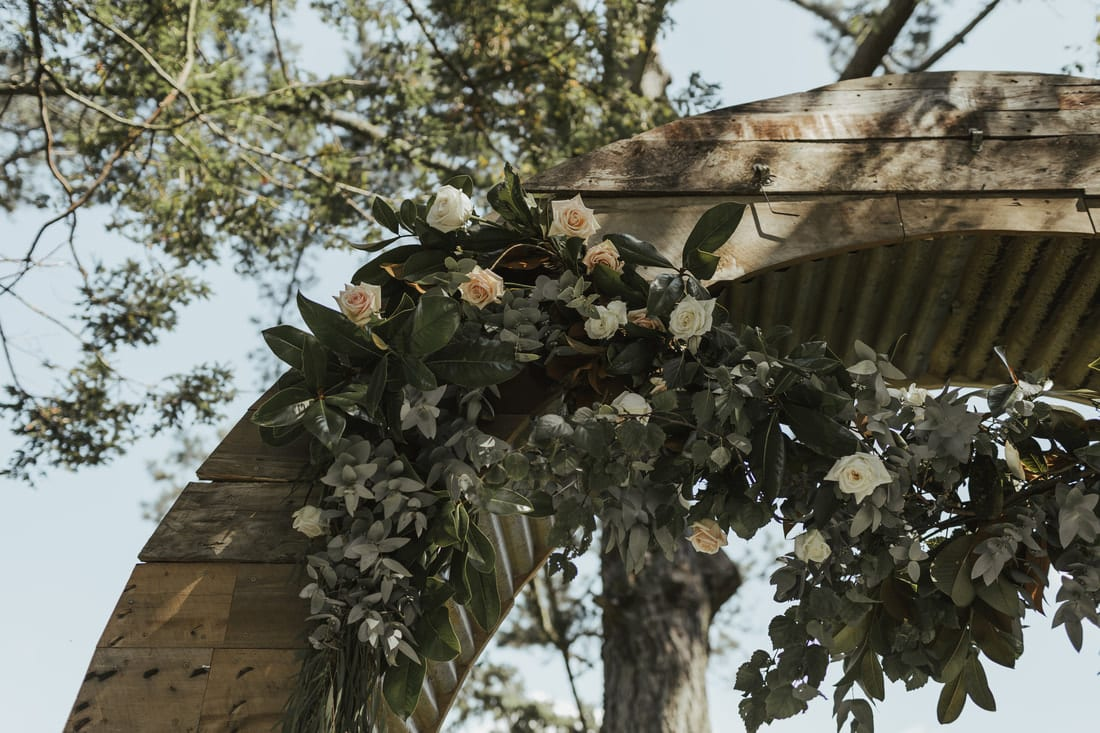 Real Weddings | Vinka Design | Real Brides Wearing Vinka Gowns | Briar and Corey archway flowers