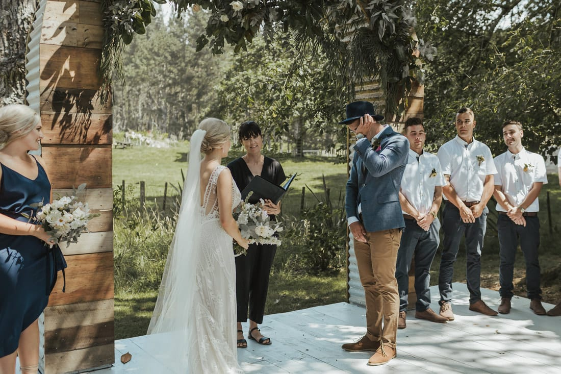 Real Weddings | Vinka Design | Real Brides Wearing Vinka Gowns | Briar and Corey ceremony under archway in gardens