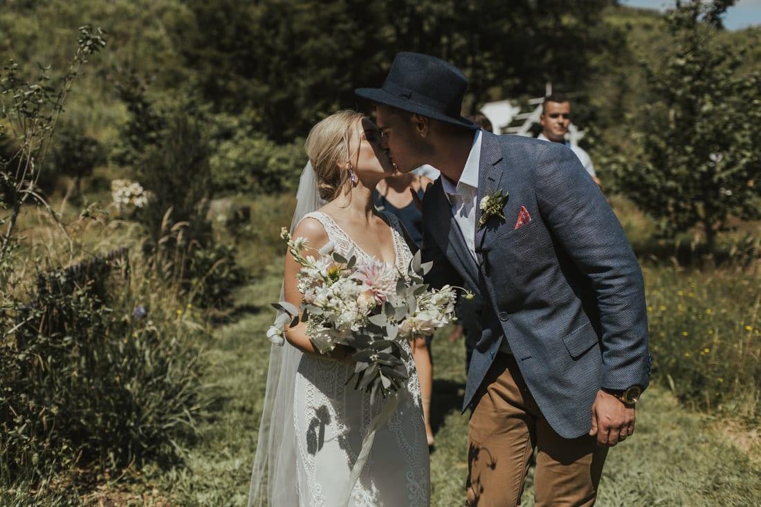 Real Weddings | Vinka Design | Real Brides Wearing Vinka Gowns | Briar and Corey kissing outdoors