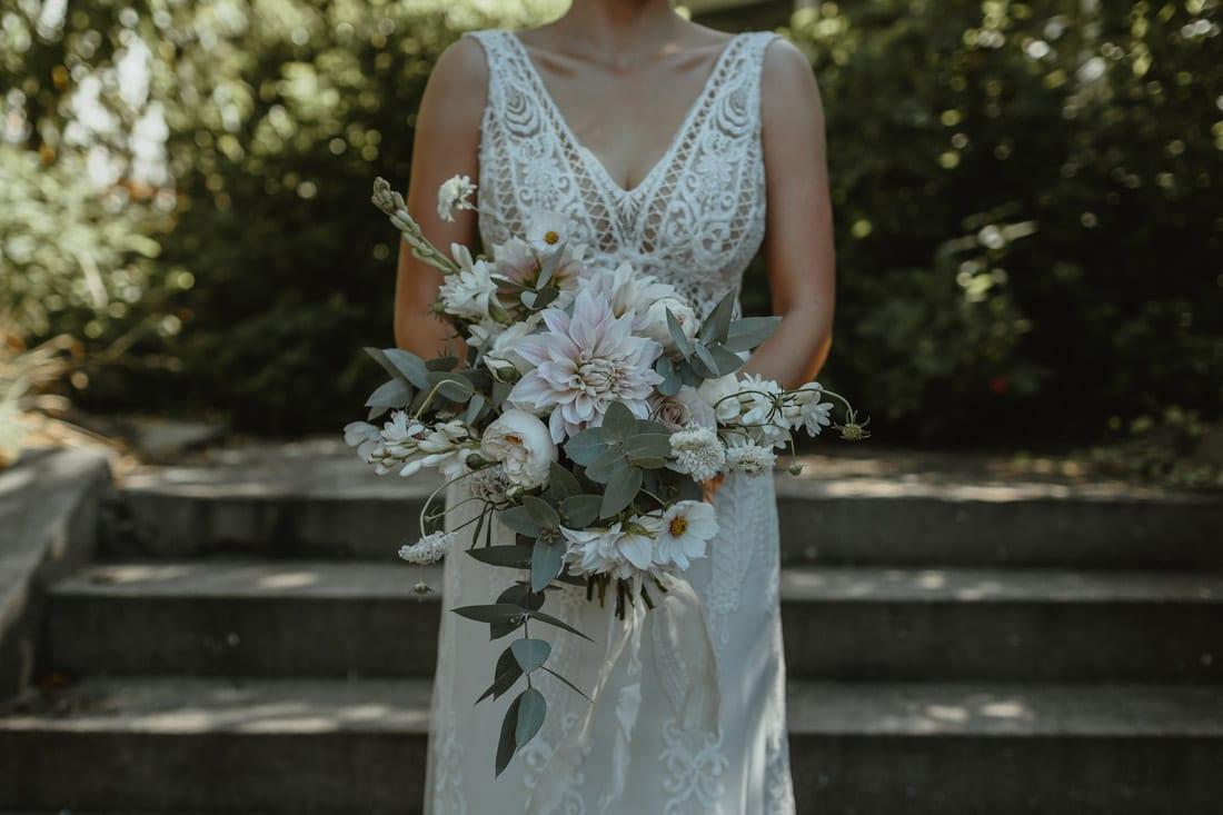Real Weddings | Vinka Design | Real Brides Wearing Vinka Gowns | Briar and Corey - close up of beautiful bespoke gown front and bouquet