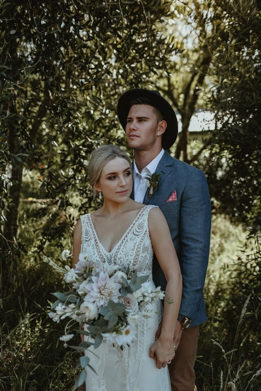 Real Weddings | Vinka Design | Real Brides Wearing Vinka Gowns | Briar and Corey in wooded area dress front with v neck