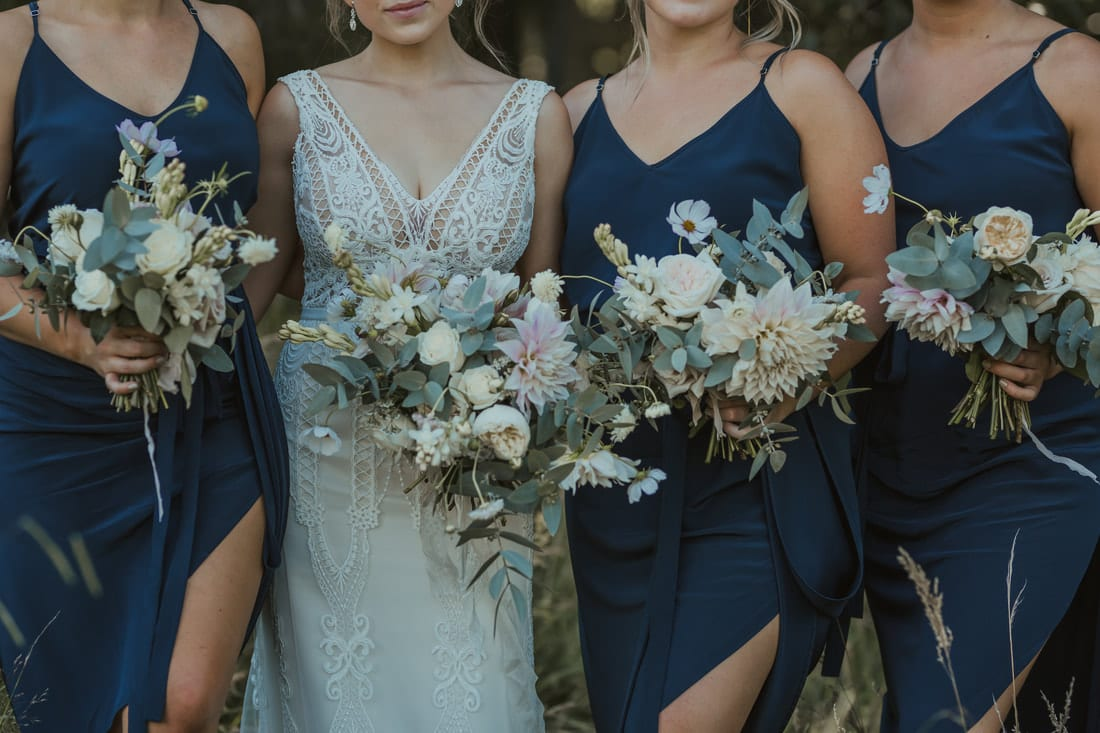 Real Weddings | Vinka Design | Real Brides Wearing Vinka Gowns | Briar and Corey - bride and bridesmaids lower halves with bouquets