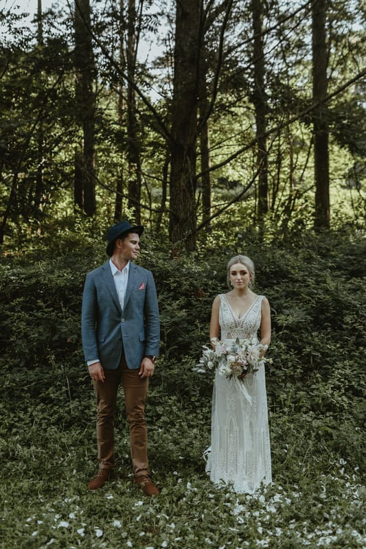 Real Weddings | Vinka Design | Real Brides Wearing Vinka Gowns | Briar and Corey side by side in woodlands