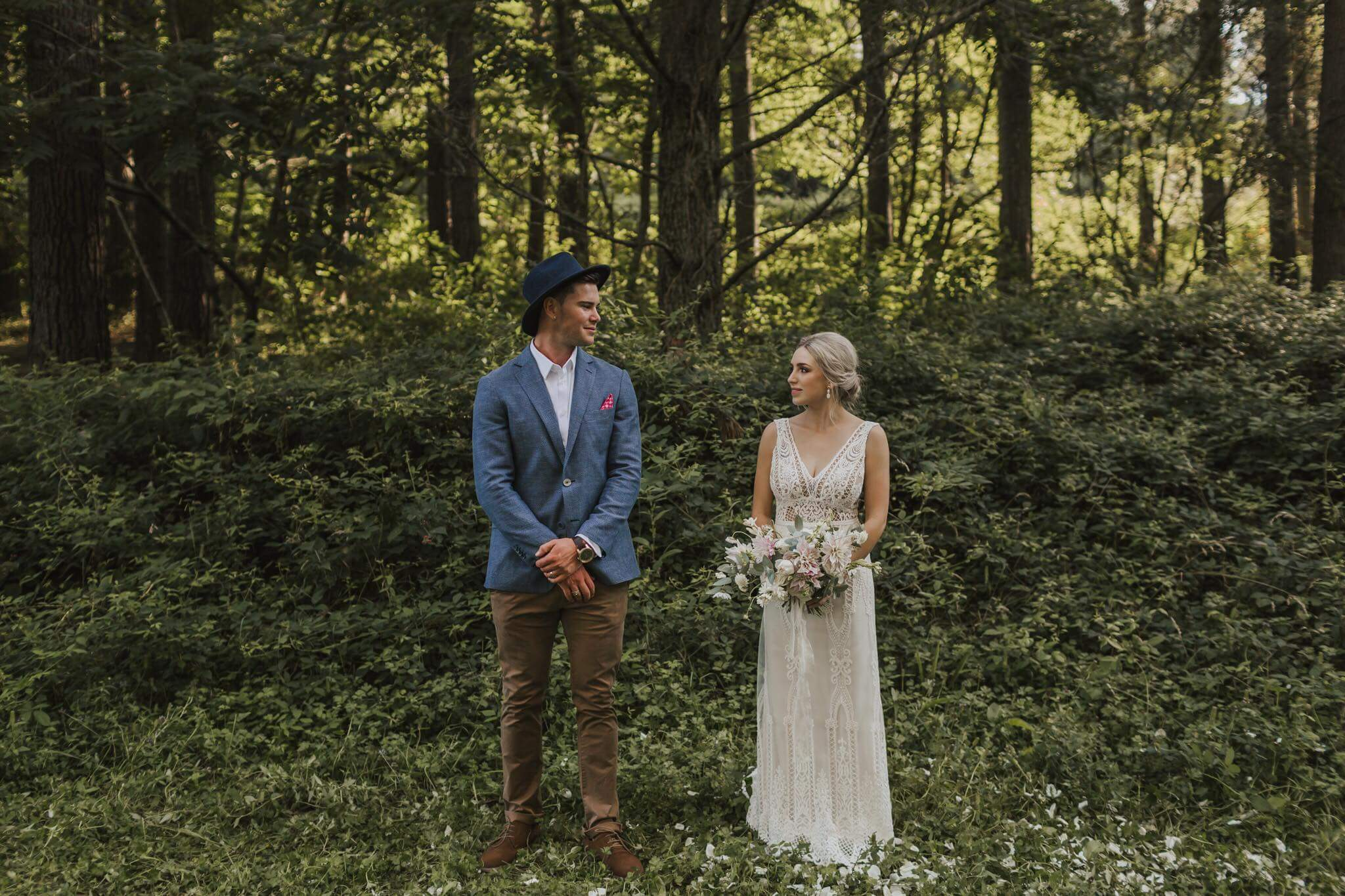 Real Weddings | Vinka Design | Real Brides Wearing Vinka Gowns | Briar and Corey side by side in the woods