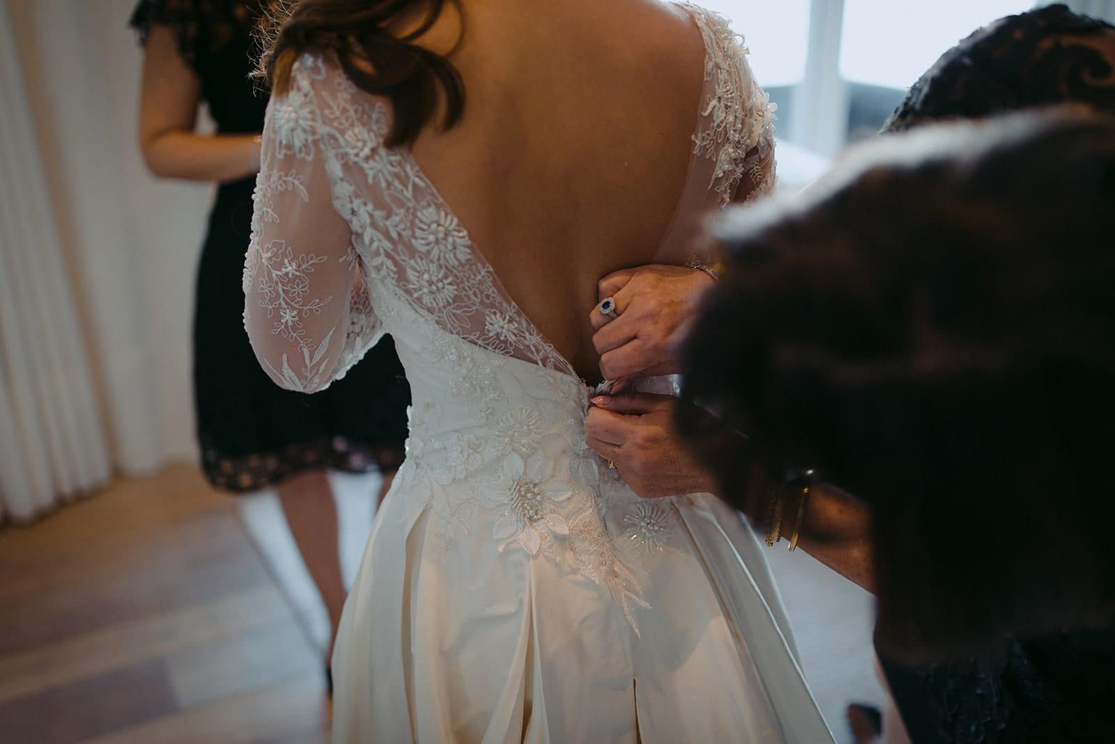 Real Weddings | Vinka Design | Real Brides Wearing Vinka Gowns | Sara and Ben -Sara having low v back of bespoke gown fastened