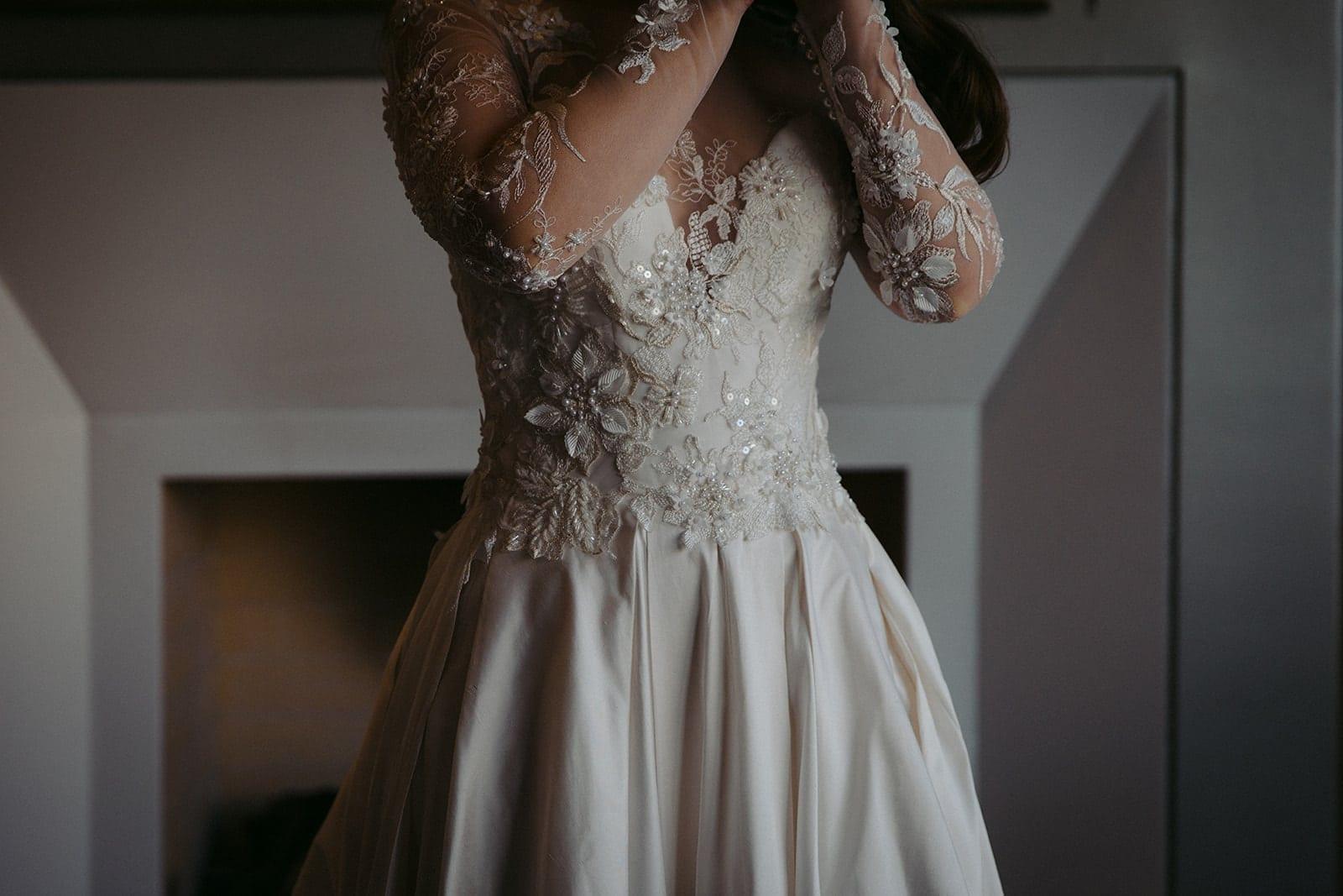 Real Weddings | Vinka Design | Real Brides Wearing Vinka Gowns | Sara and Ben - Sara lower half showing beautiful detail of bespoke wedding gown