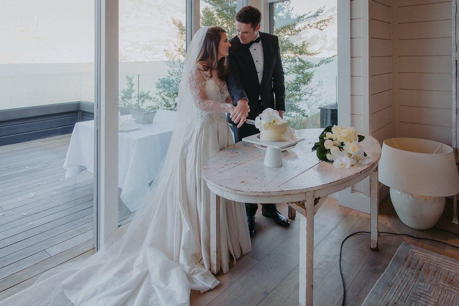 Real Weddings | Vinka Design | Real Brides Wearing Vinka Gowns | Sara and Ben cutting cake