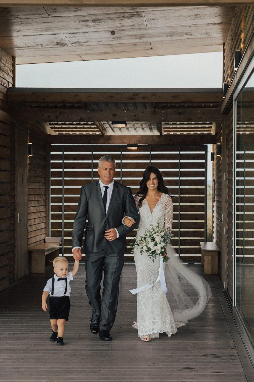 Real Weddings | Vinka Design | Real Brides Wearing Vinka Gowns | Nicole and Hayden - Nicole walking through venue