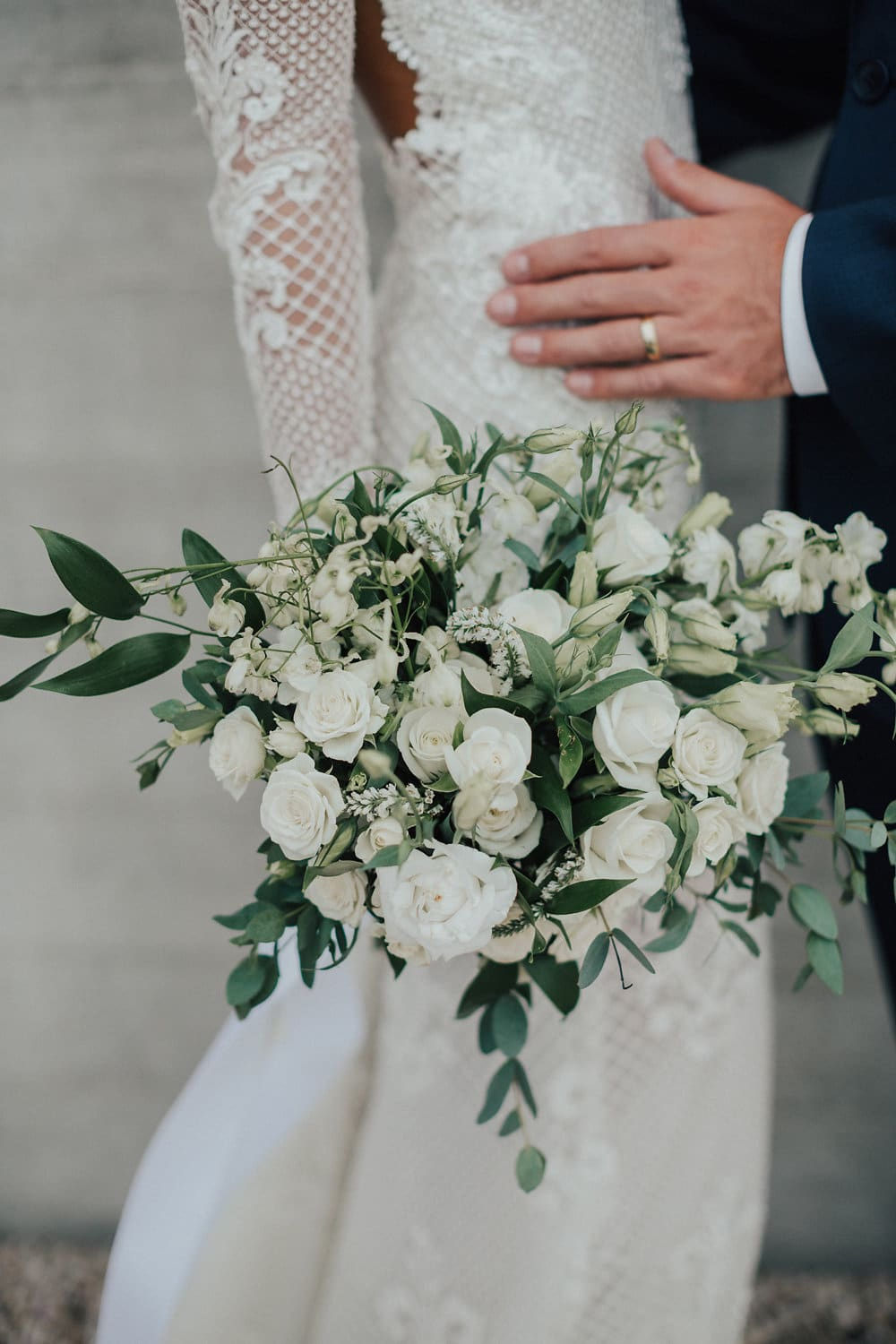 Real Weddings | Vinka Design | Real Brides Wearing Vinka Gowns | Nicole and Hayden close up of lower half displaying bouquet and beautiful custom dress