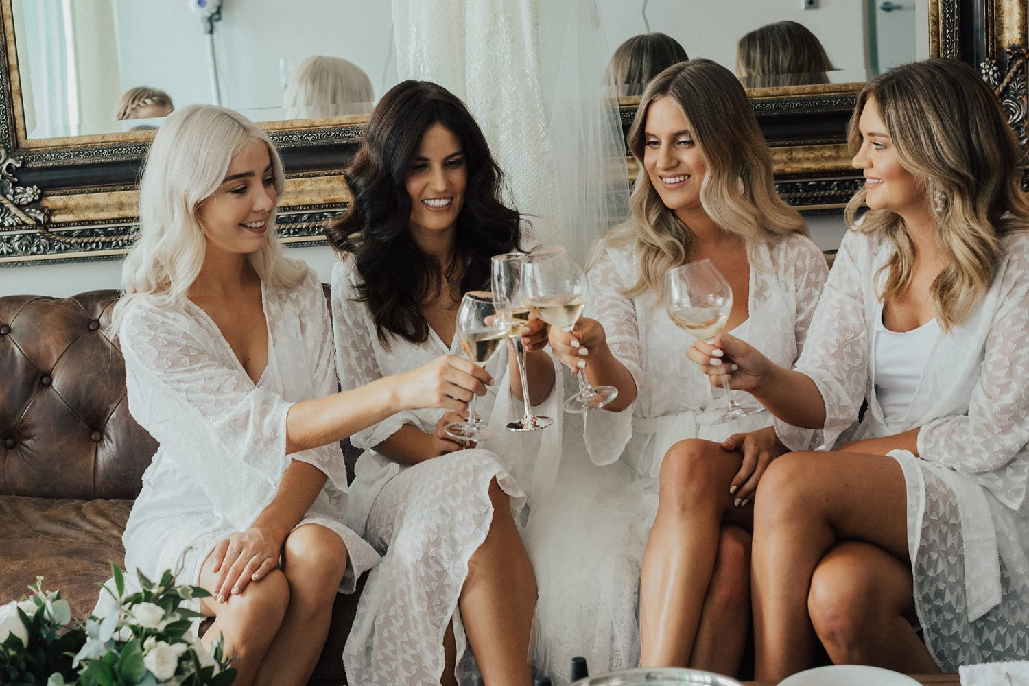 Real Weddings | Vinka Design | Real Brides Wearing Vinka Gowns | Nicole and Hayden - Nicole and bridesmaids cheers before getting ready