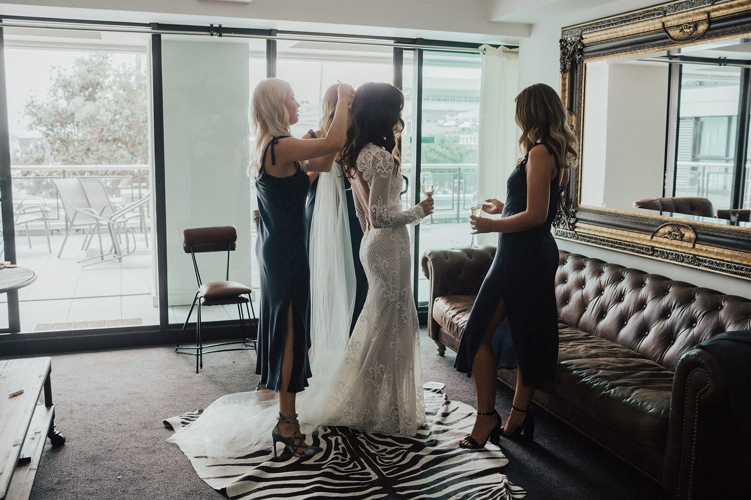 Real Weddings | Vinka Design | Real Brides Wearing Vinka Gowns | Nicole and Hayden - Nicole and bridesmaids attending in living room