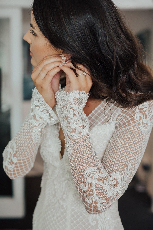 Real Weddings | Vinka Design | Real Brides Wearing Vinka Gowns | Nicole and Hayden - Nicole putting on earrings