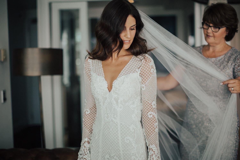 Real Weddings | Vinka Design | Real Brides Wearing Vinka Gowns | Nicole and Hayden - Nicole having veil positioned