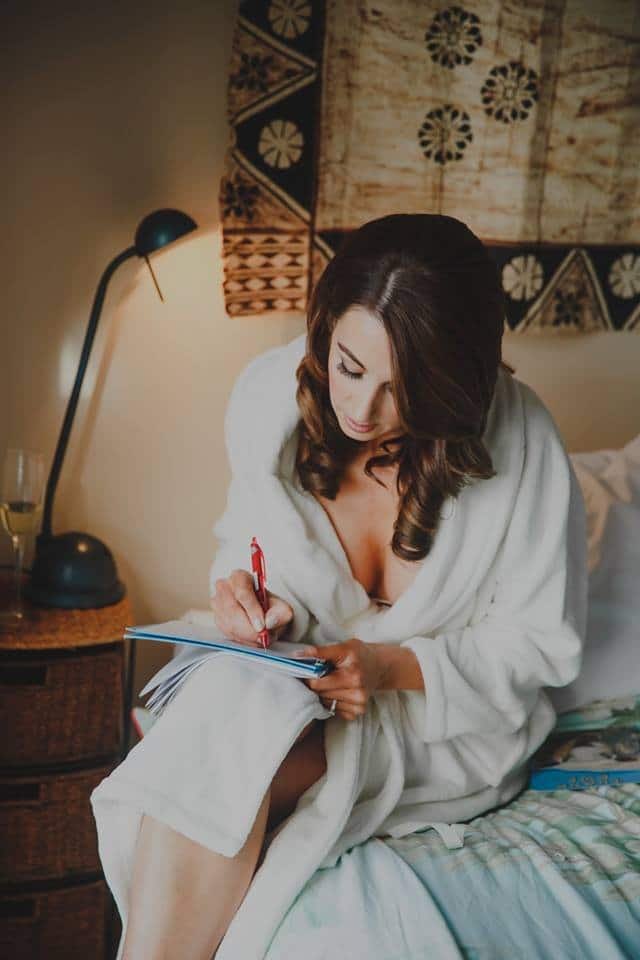 Real Weddings | Vinka Design | Real Brides Wearing Vinka Gowns | Haley and Mike - Haley writing in dressing gown