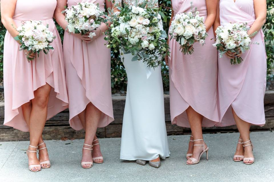 Real Weddings | Vinka Design | Real Brides Wearing Vinka Gowns | Haley and Mike - Bride and bridesmaids lower halves showing beautiful silk wedding dress skirt and shoes