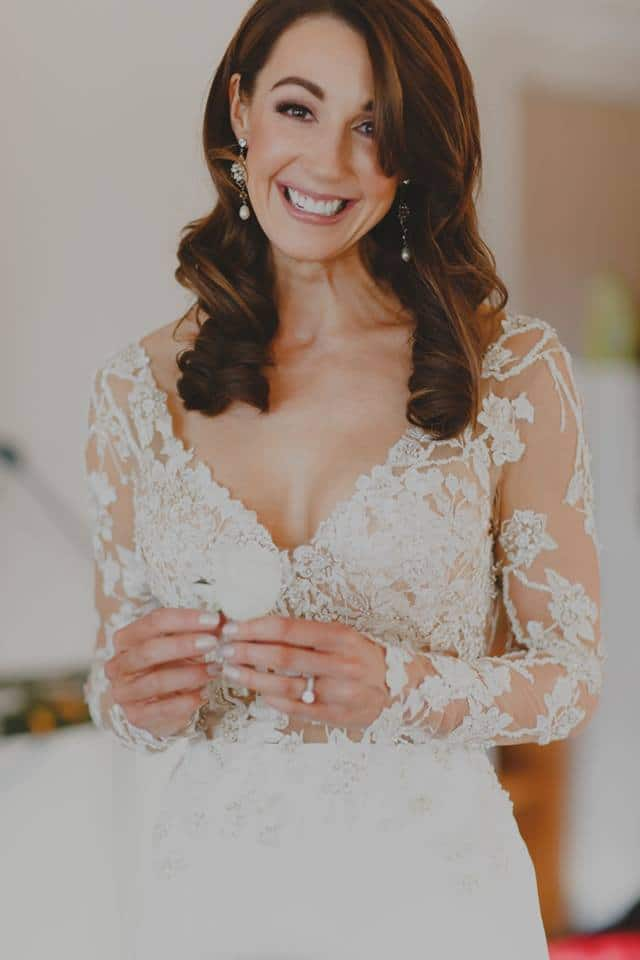 Real Weddings | Vinka Design | Real Brides Wearing Vinka Gowns | Haley and Mike - Haley portrait smiling beautiful dress detail long lace sleeves v neck