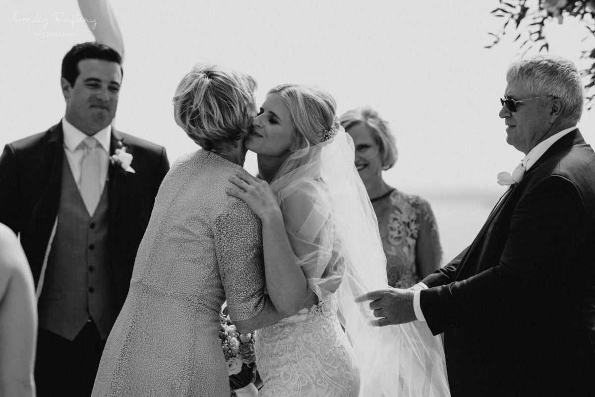 Real Weddings | Vinka Design | Real Brides Wearing Vinka Gowns | Kate and Graeme - Kate kissing family in black and white