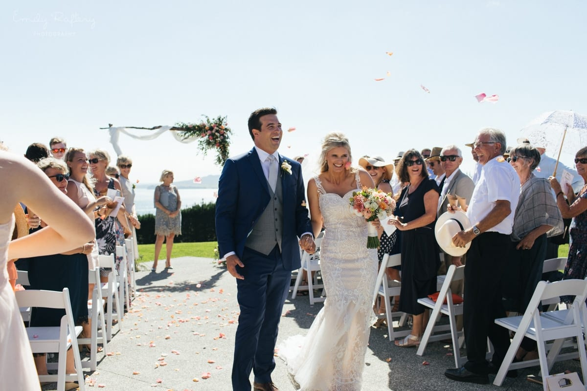 Real Weddings | Vinka Design | Real Brides Wearing Vinka Gowns | Kate and Graeme just married walking up aisle outdoors