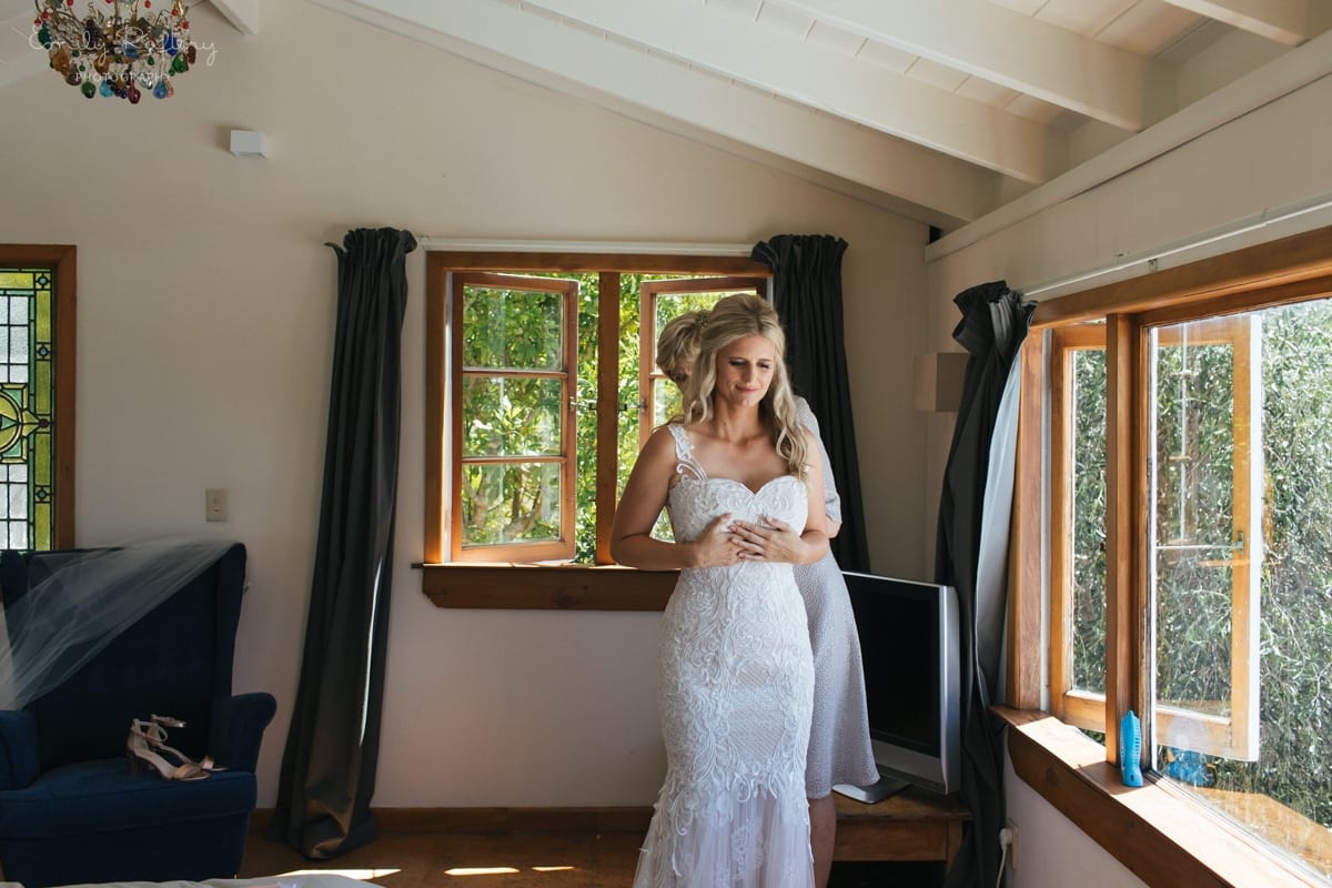Real Weddings | Vinka Design | Real Brides Wearing Vinka Gowns | Kate and Graeme - Kate being fitted into custom made dress