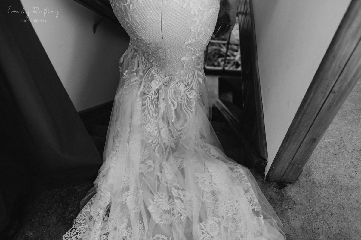 Real Weddings | Vinka Design | Real Brides Wearing Vinka Gowns | Kate and Graeme - custom made dress from bottom walking down stairs showing layers and beautiful lace dress