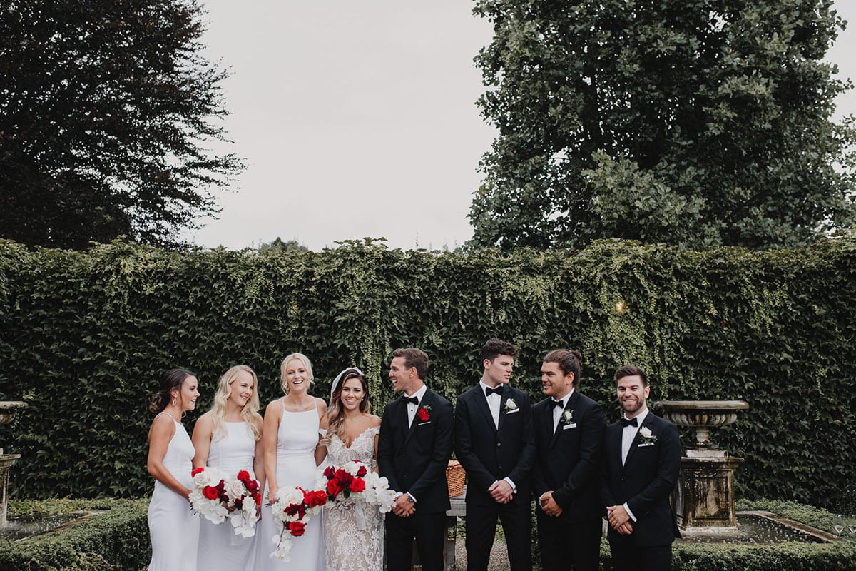 Real Weddings   Vinka Design   Real Brides Wearing Vinka Gowns   Amber and Rhys bridal party casual pose