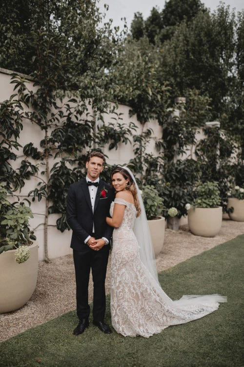 Real Weddings | Vinka Design | Real Brides Wearing Vinka Gowns | Amber and Rhys wedding ceremony black and white with off shoulder custom made wedding dress and overtrain detail