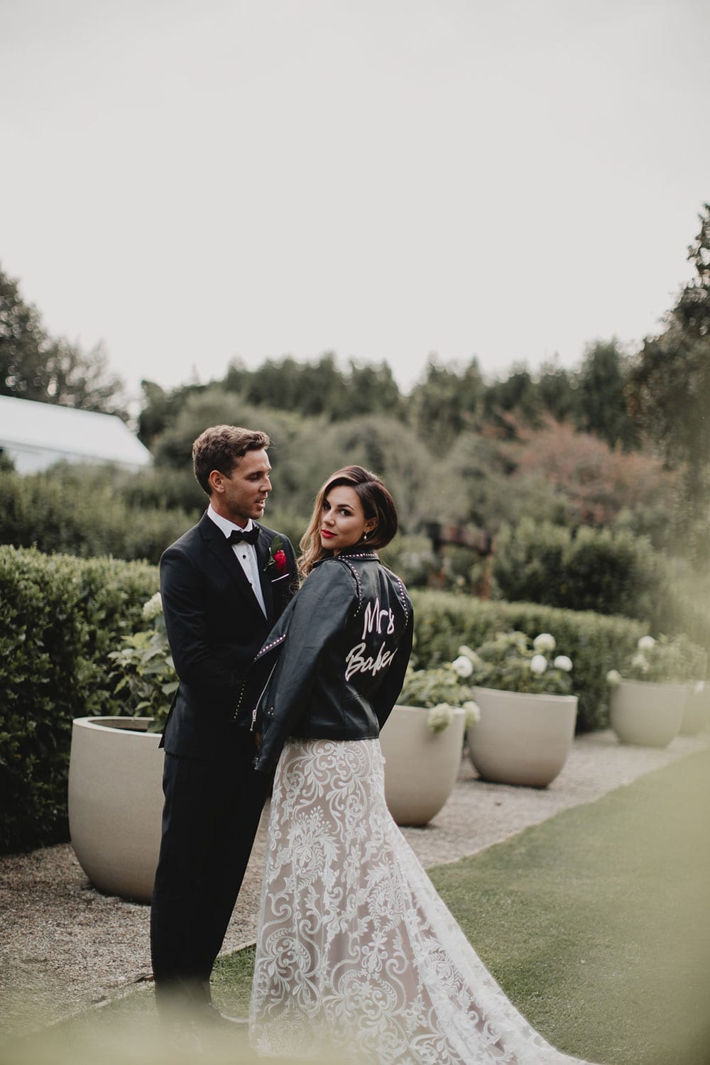 Real Weddings | Vinka Design | Real Brides Wearing Vinka Gowns | Amber and Rhys in gardens showing beautiful detail of train of custom made wedding dress