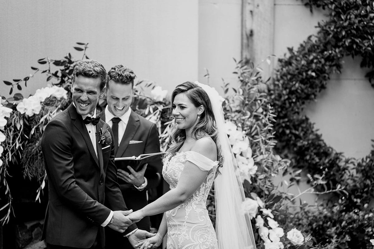Real Weddings | Vinka Design | Real Brides Wearing Vinka Gowns | Amber and Rhys wedding ceremony black and white with off shoulder custom made wedding dress
