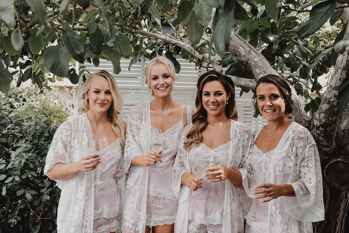 Real Weddings | Vinka Design | Real Brides Wearing Vinka Gowns | Amber and Rhys - Amber and bridesmaids outdoors before getting ready