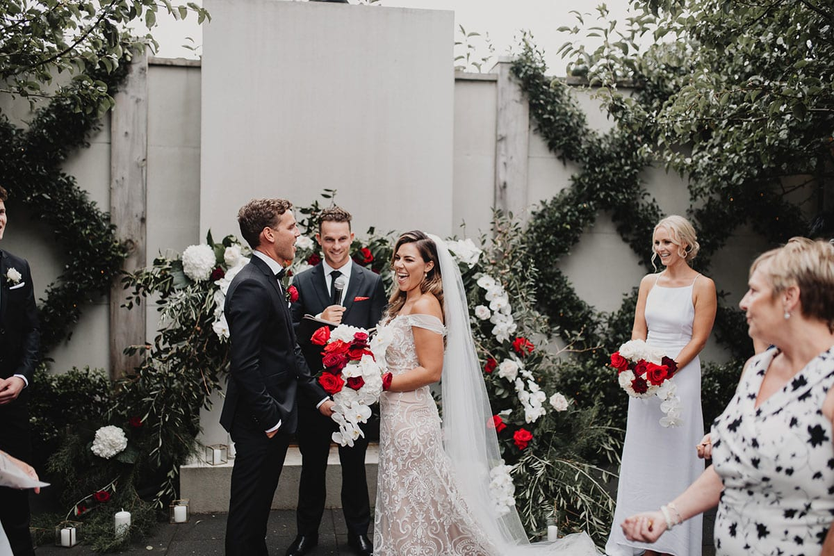 Real Weddings   Vinka Design   Real Brides Wearing Vinka Gowns   Amber and Rhys wedding ceremony laughing
