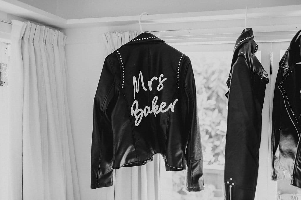 Real Weddings | Vinka Design | Real Brides Wearing Vinka Gowns | Amber and Rhys - leather jacket for bride
